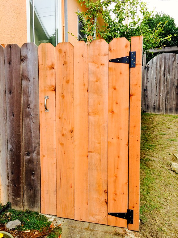 Fence door rebuilt  to stop vermin.